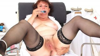 Eager head practical nurse playing with herself in her uniform Thumbnail