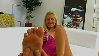 Phoenix Marie gives a footjob