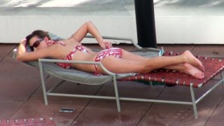 Kinky Alora James is fed up with sunbathing and wants to win a cock Thumbnail
