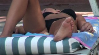 Sexy brunette Kari Sweet is sunbathing and giving a blowjob to the stranger Thumbnail